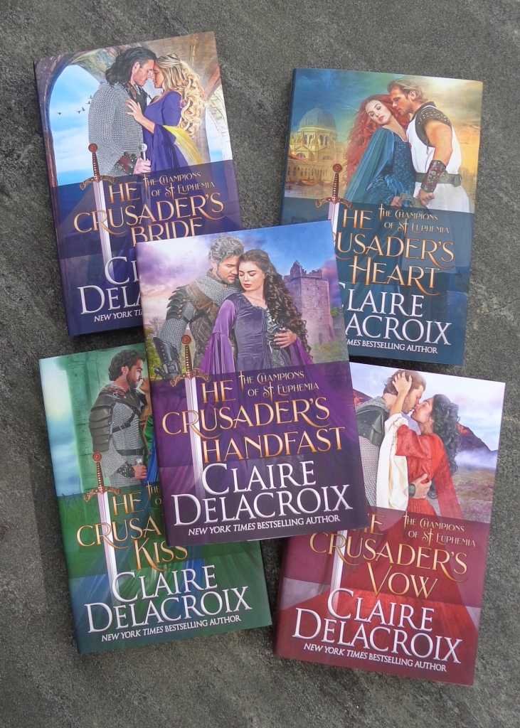 The Champions of St. Euphemia series of medieval romances by Claire Delacroix, in their hard cover editions.